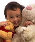 Little Girl Cuddling Soft Toys