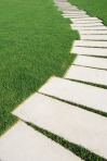 Serpentine pathway stones on a park lawn (concept)