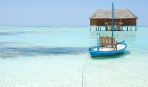 Honeymoon villa in Maldives and typical boat