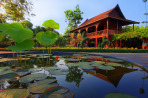 Thai style house reflected in lotus pond,Thailand