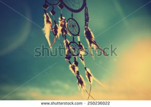 stock-photo-dream-catcher-with-sky-at-sunset-in-background-250236022