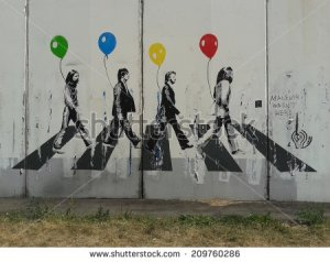 stock-photo-moscow-august-the-beatles-abbey-road-graffiti-on-the-white-wall-in-moscow-august-209760286