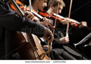 stock-photo-symphony-concert-a-man-playing-the-cello-hand-close-up-120211552