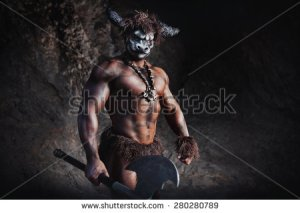 stock-photo-the-bodyart-man-angry-minotaur-with-axe-in-cave-280280789