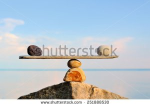 stock-photo-balancing-of-pebbles-on-the-top-of-stone-251888530