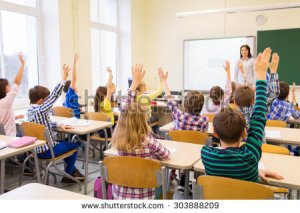 stock-photo-education-elementary-school-learning-and-people-concept-group-of-school-kids-with-teacher-303888209