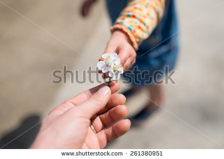 stock-photo-mother-and-child-to-hand-over-the-plum-flower-261380951
