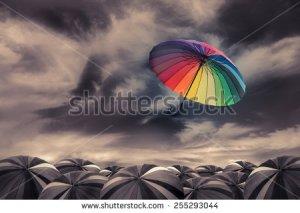 stock-photo-rainbow-umbrella-fly-out-the-mass-of-black-umbrellas-255293044