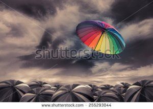 stock-photo-rainbow-umbrella-fly-out-the-mass-of-black-umbrellas-255293044