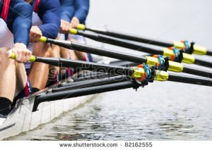 stock-photo-close-up-of-a-men-s-quadruple-skulls-rowing-team-seconds-after-the-start-of-their-race-82162555
