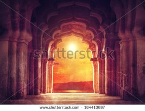 stock-photo-old-ruined-arch-in-ancient-temple-at-sunset-in-india-164410697