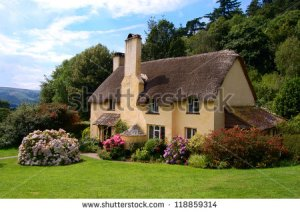 stock-photo-thatched-roof-cottage-in-selworthy-village-somerset-118859314