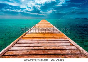 stock-photo-empty-wooden-dock-over-tropical-blue-water-287475896