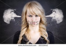 stock-photo-closeup-portrait-of-angry-young-woman-blowing-steam-coming-out-of-ears-about-to-have-nervous-181519442