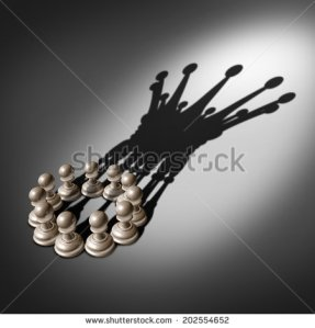 stock-photo-leadership-team-and-business-group-concept-as-an-organized-company-of-chess-pawn-pieces-joining-202554652