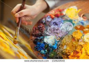 stock-photo-artist-paints-a-picture-of-oil-paint-brush-in-hand-with-palette-closeup-132622640