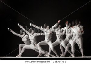 stock-photo-full-length-portrait-of-woman-wearing-white-fencing-costume-and-black-fencing-mask-practicing-with-351364763