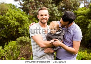 stock-photo-smiling-gay-couple-with-child-in-garden-387160129
