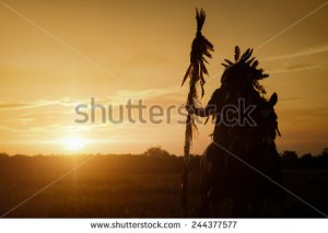 stock-photo-the-indians-are-riding-a-horse-and-spear-ready-to-use-in-light-of-the-silhouette-244377577