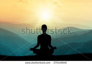 stock-photo--yoga-and-meditation-silhouette-275140940