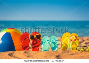 stock-photo-flip-flops-beach-ball-and-snorkel-on-the-sand-summer-vacation-concept-277455644
