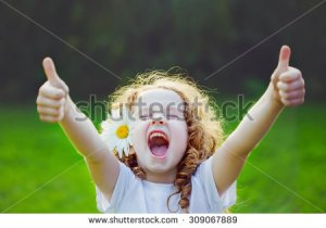 stock-photo-laughing-girl-with-daisy-in-her-hairs-showing-thumbs-up-309067889