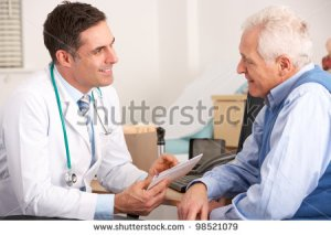 stock-photo-american-doctor-talking-to-senior-man-in-surgery-98521079