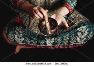 stock-photo-tibetan-singing-bowl-in-the-hands-of-a-girl-in-national-costume-399189997