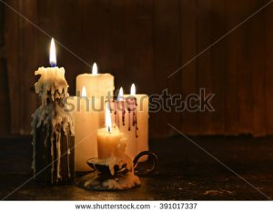 stock-photo-group-of-evil-candles-burning-in-the-darkness-and-copy-space-on-wooden-background-black-magic-391017337