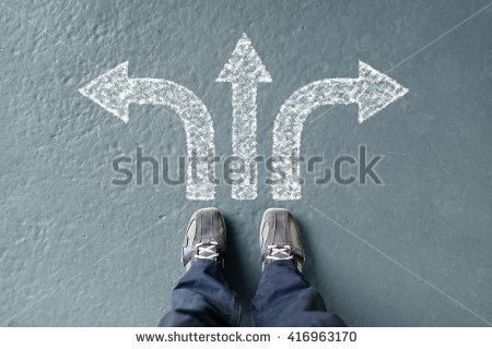 stock-photo-taking-decisions-for-the-future-man-standing-with-three-direction-arrow-choices-left-right-or-416963170