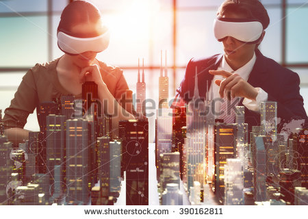 stock-photo-two-business-persons-are-developing-a-project-using-virtual-reality-goggles-the-concept-of-390162811