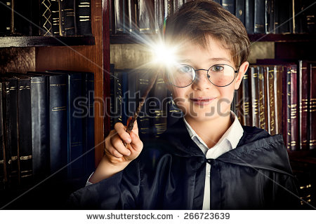 stock-photo-a-boy-stands-with-magic-wand-in-the-library-by-the-bookshelves-with-many-old-books-fairy-tales-266723639