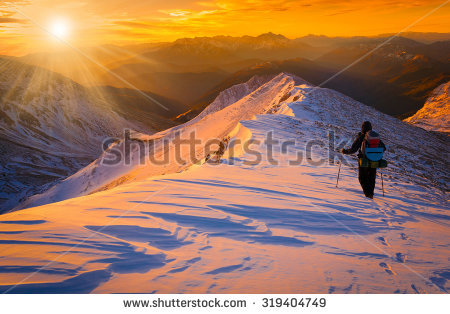 stock-photo-beautiful-amazing-sunset-winter-mountains-a-man-goes-a-sport-hike-in-snow-holidays-christmas-319404749