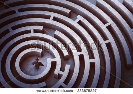 stock-photo-businessman-at-the-center-of-a-maze-333678827
