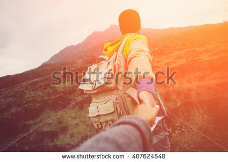 stock-photo-brave-and-romantic-traveler-guiding-woman-to-the-mountain-in-the-wild-intentional-sun-glare-and-407624548