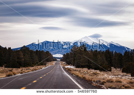 stock-photo-snow-covered-san-francisco-peak-flagstaff-arizona-with-lenticular-clouds-546597760