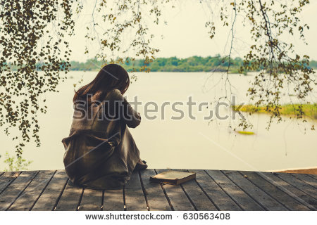 stock-photo-lonely-sad-woman-630563408