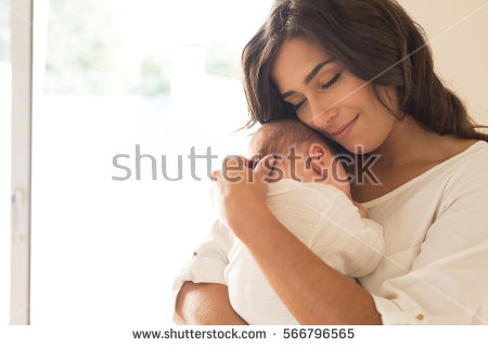stock-photo-pretty-woman-holding-a-newborn-baby-in-her-arms-566796565