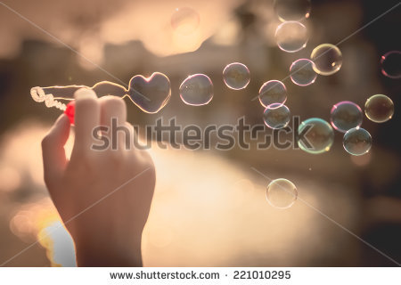 stock-photo--my-heart-bubbles-at-the-sky-sunset-love-in-the-summer-sun-with-bubble-blower-romantic-inflating-221010295